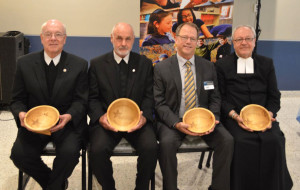 Award recipients, from left, Brother James Gaffney, FSC, Brother Robert Walsh, FSC, Thaddeus (Tad) Smith, and Brother Stephen Markham, FSC.