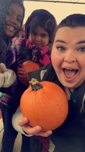 Molly taking students to a pumpkin patch